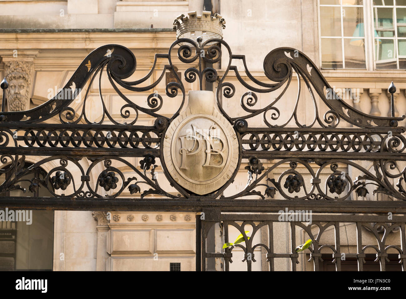 UK City of London Financial District ornate wrought iron metalwork entrance to Adams Court gold golden crown plaque PNB - Stock Image
