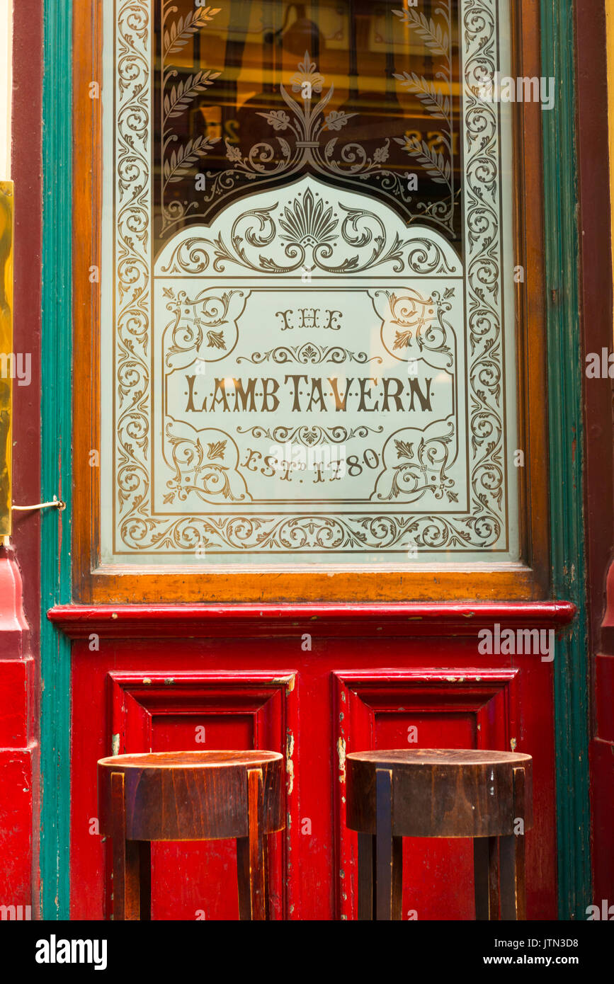 UK London City Leadenhall Market since 14th century was for cheese meat flowers detail door window The Lamb Tavern Stock Photo