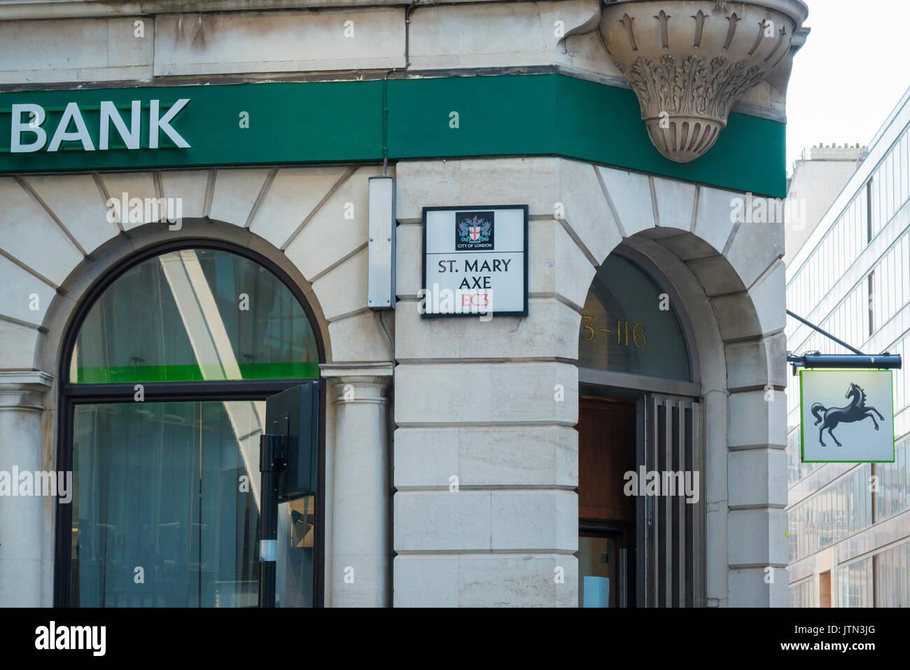 UK London City EC3 Financial Centre Center Lloyds Bank branch St Mary Axe road sign logo black horse street scene - Stock Image