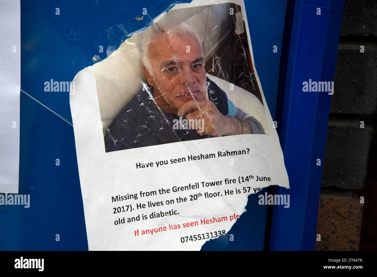 A poster seeking help in finding Hesham Rahman, one of the victims of the catastrophic fire of June 14th 2017 in the Grenfell Tower, West London - Stock Image