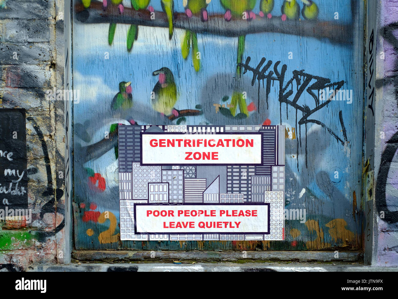 Protests against Gentrification on the wall of a derelict pub in Hackney Wick, East London, August 2017 - Stock Image
