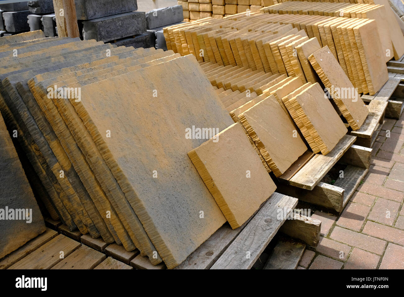 Stacks of paving slabs on sale at an English garden centre - Stock Image