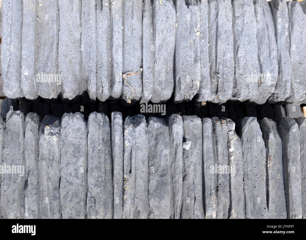 Slate block walling for finishing off the top of a slate wall - Stock Image