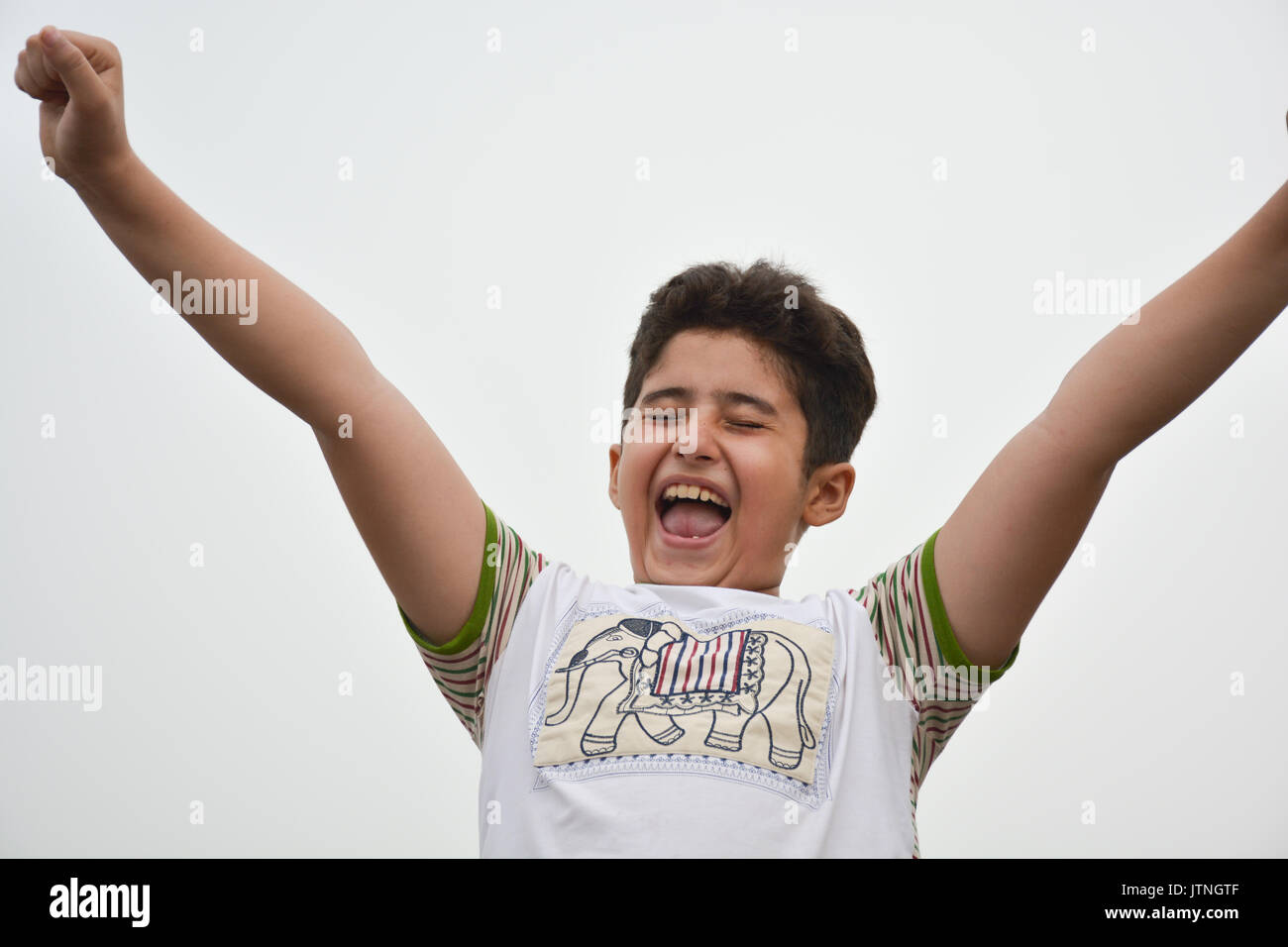 A Child Expressing How Happy He is! - Stock Image