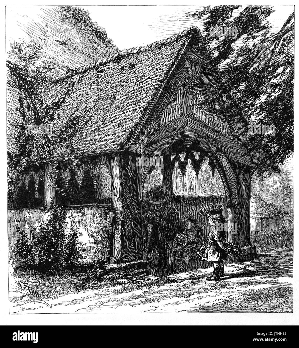 1870:  An old man and two young girls in the lovely old porch of the Norman Saint Giles church in Stoke Poges, a village in the South Bucks district of Buckinghamshire, England. Thomas Gray's  'Elegy Written in a Country Churchyard' is believed to have been written in the churchyard. - Stock Image