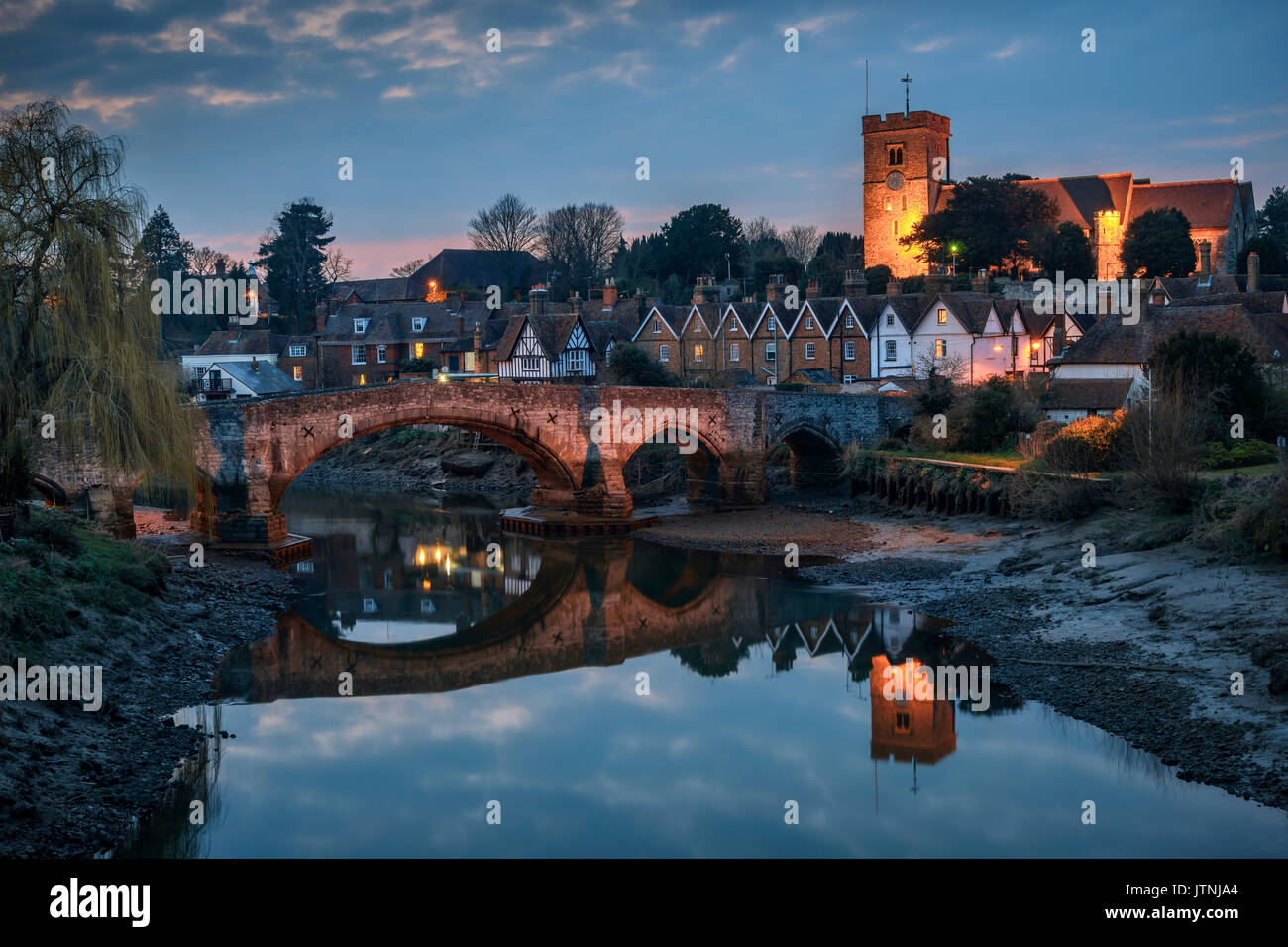 Aylesford, United Kingdom - March 22nd, 2016: Night view to Aylesford village in Kent, England with medieval bridge and church. - Stock Image