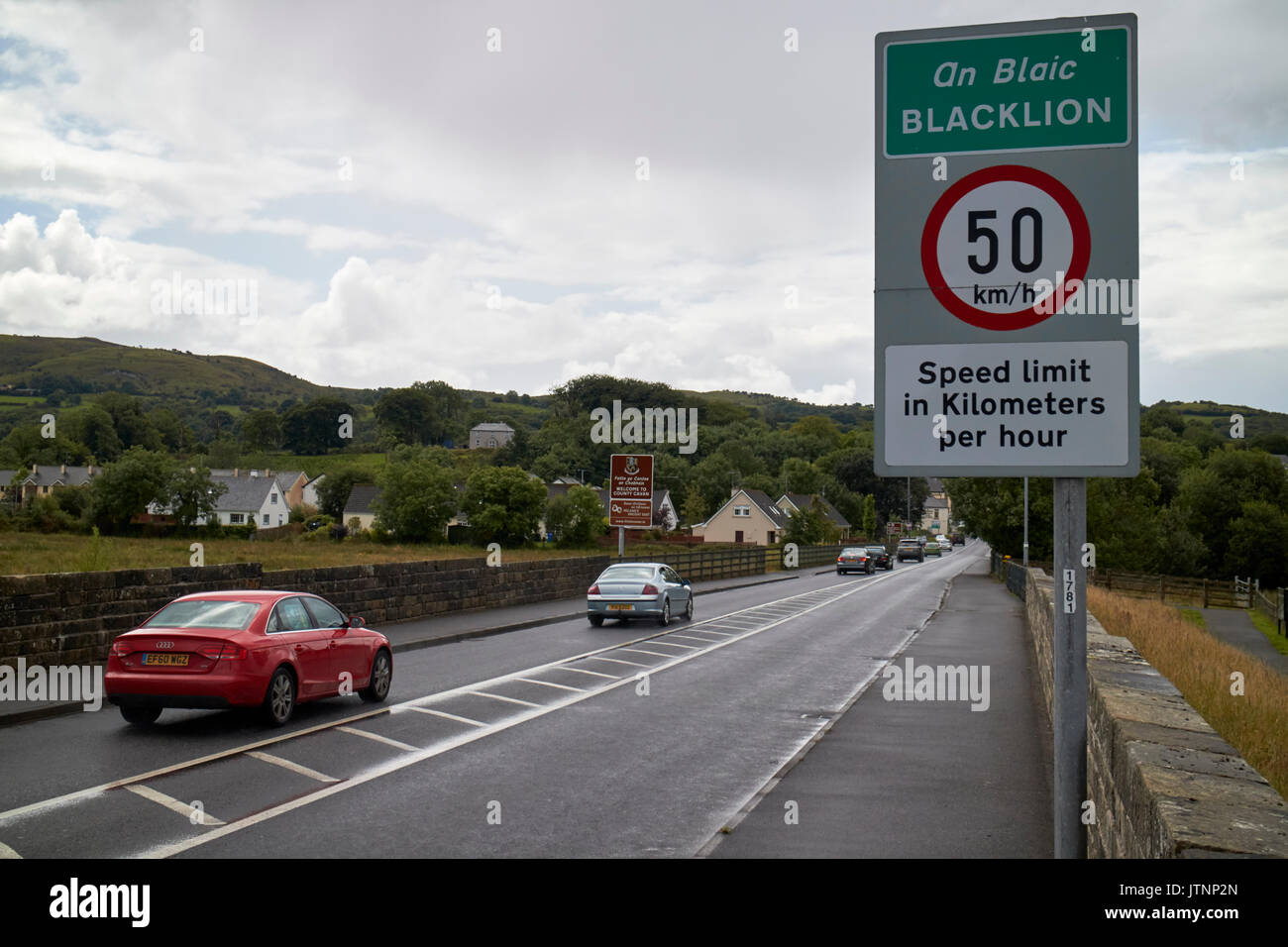 speed limit metric sign on land border between northern ireland and the republic of ireland in belcoo - blacklion looking into the republic of ireland - Stock Image