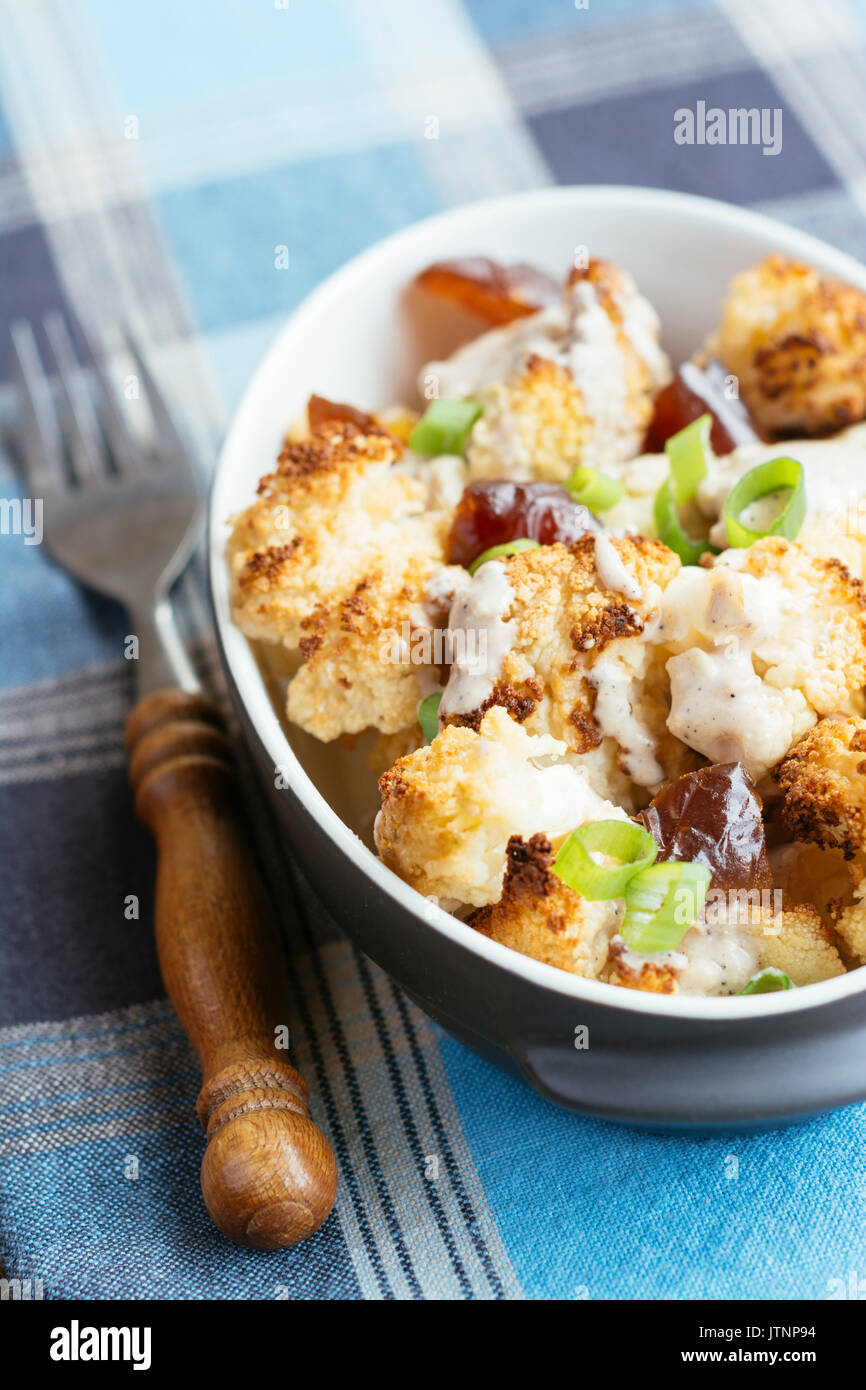 Roasted Cauliflower with Dates and Tahini Dressing Stock Photo