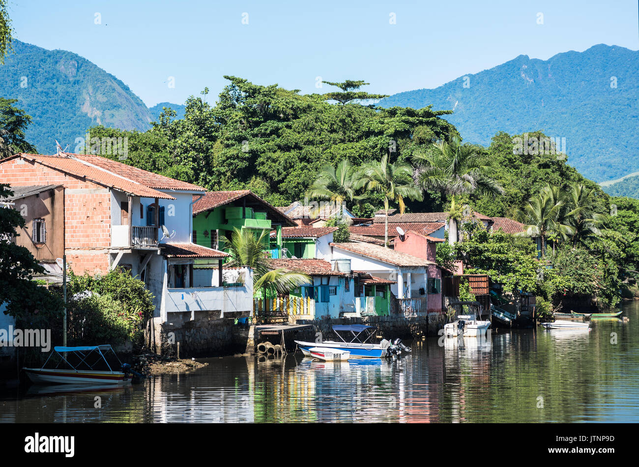 Paraty, Brazil - February 24, 2017: View of the canal and the colonial houses of the historic town Paraty, Rio de Janeiro state, Brazil - Stock Image