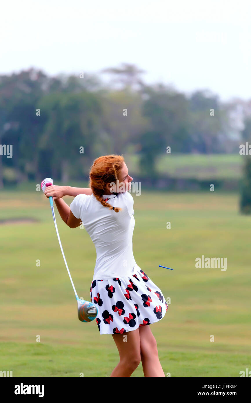 Young woman playing golf, Bali, Indonesia - Stock Image