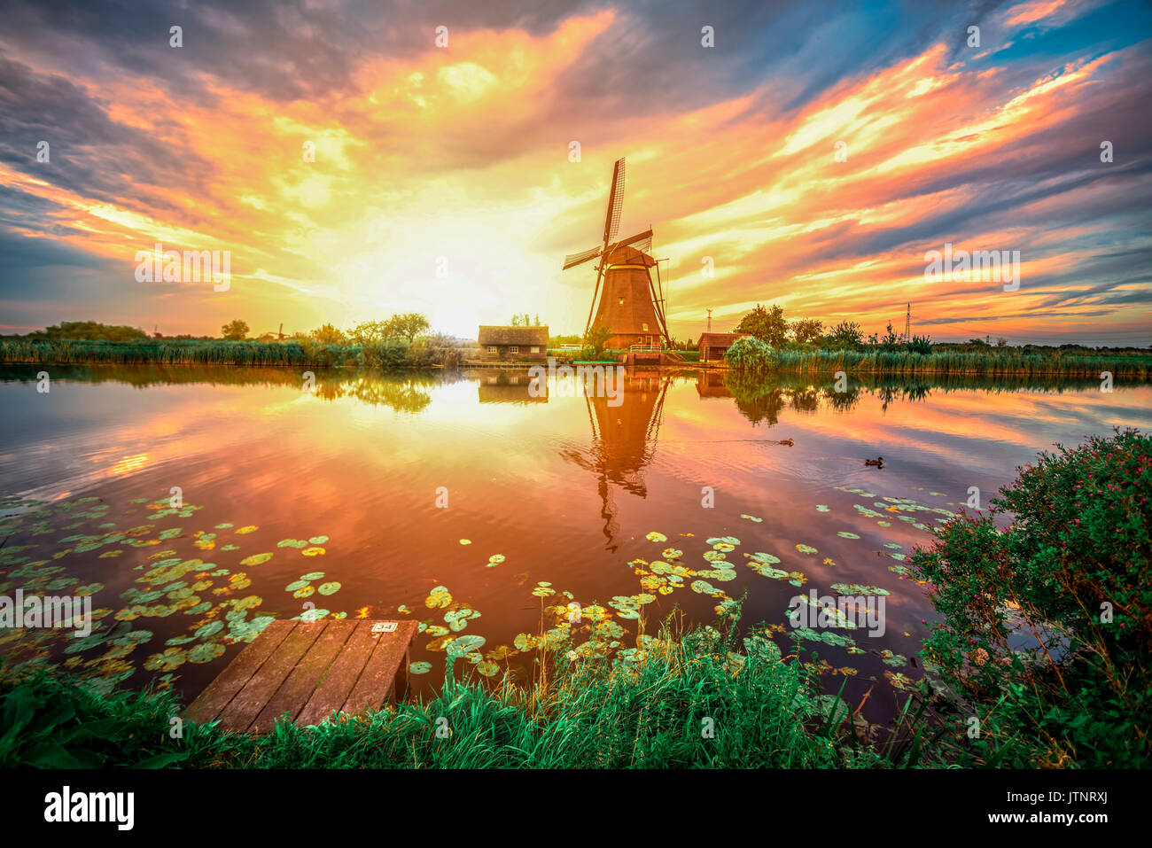 Sunrise on the Kinderdijk windmill built in 17 century, the UNESCO world heritage monuments in Alblasserdam, South West of Rotterdam, Netherlands - Stock Image