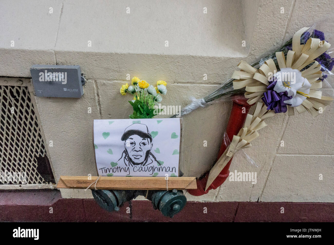 memorial tribute to black victim of hate crime include superb ink portrait of his bleak face fastened to standpipe on 36th Street NYC Garment district - Stock Image