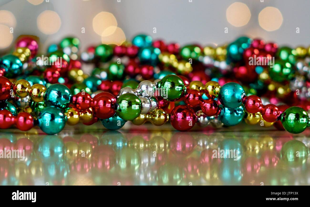 pile of brightly colored christmas garland beads