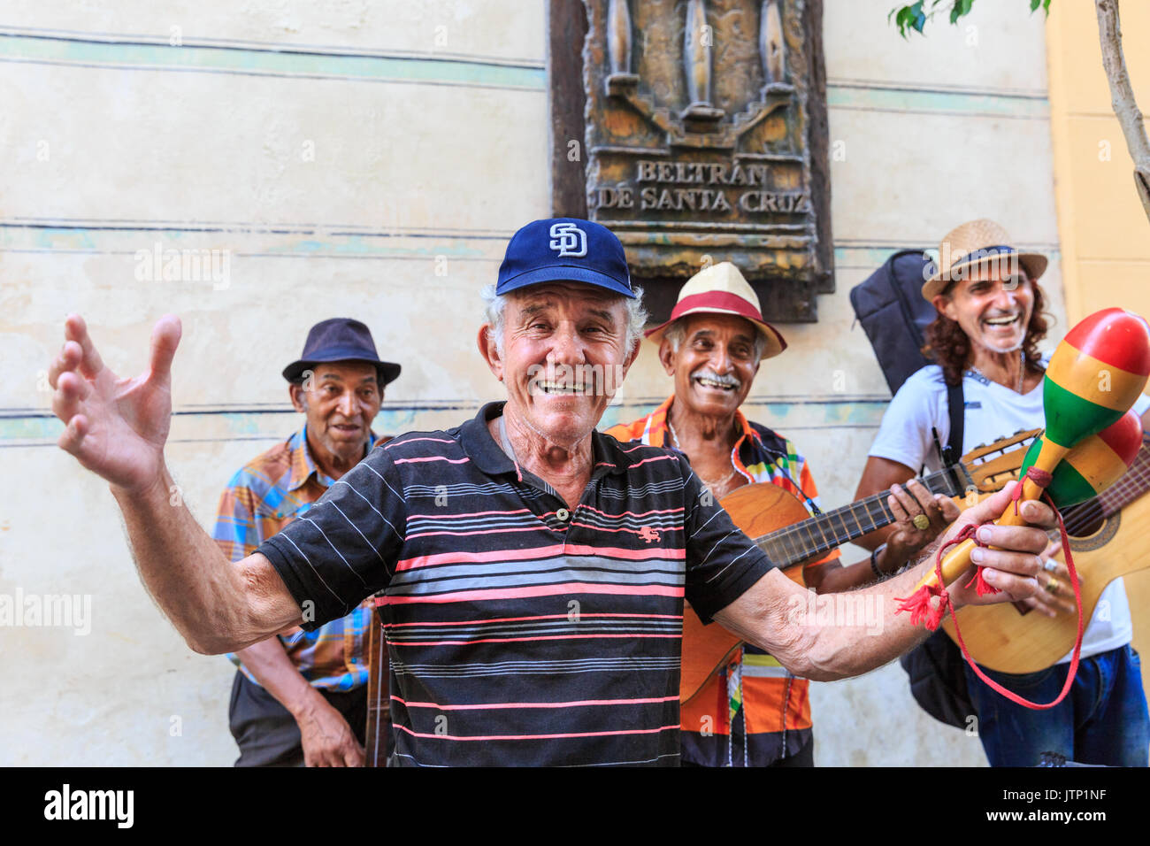 Band of musicians, group play salsa and Cuban music in the street in