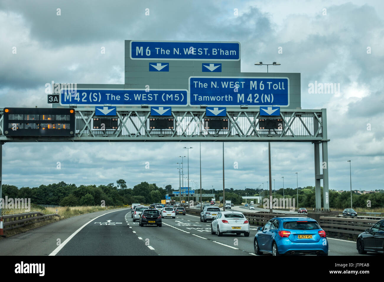 Blue sign on the M6 motorway, east of Birmingham, for the south west or north west of England, UK. - Stock Image