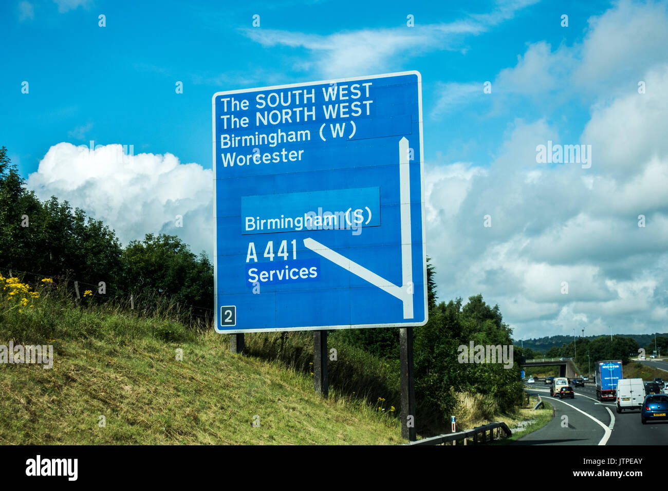 Blue sign on the M42 motorway for Birmingham, and also (heading straight ahead towards the M5), the south west and north west of England, UK. - Stock Image