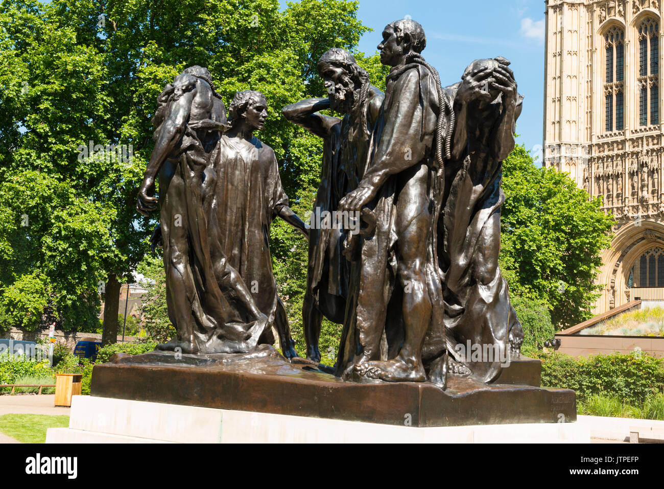 The Burghers of Calais statue sculpture bronze Auguste Rodin Victoria Tower Gardens Palace of Westminster Houses of Parliament 1884 - 89 tree trees - Stock Image