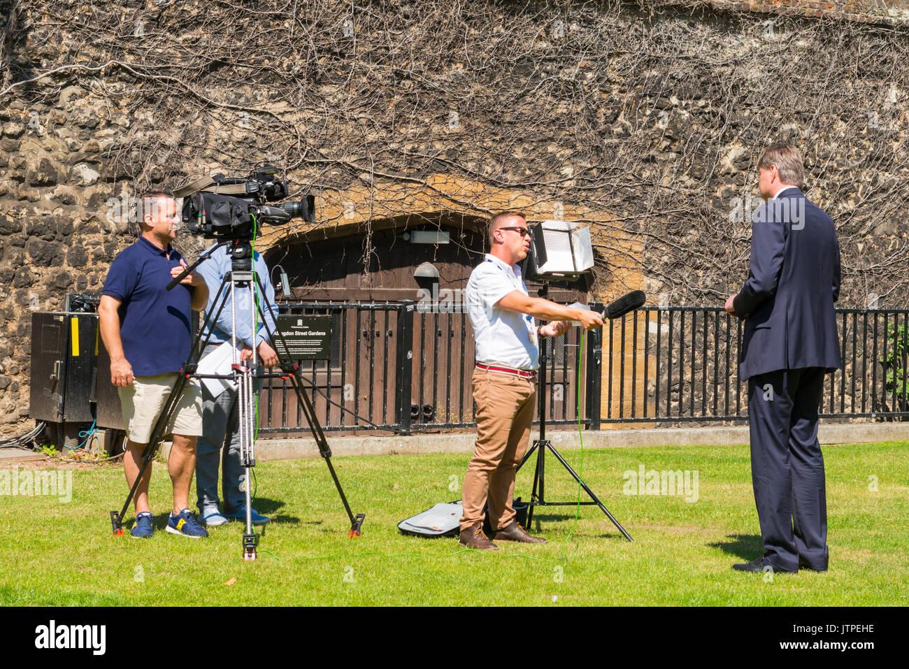 UK London Westminster Abingdon Street Gardens College Green BBC television crew interview of Daniel Kawczynski Conservative MP for Shrewsbury & Atchem - Stock Image