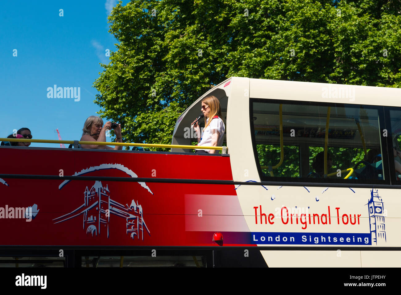 UK London Westminster Parliament Square The Original Tour London Sightseeing Tours tour guide pretty young blond microphone open top double decker bus - Stock Image
