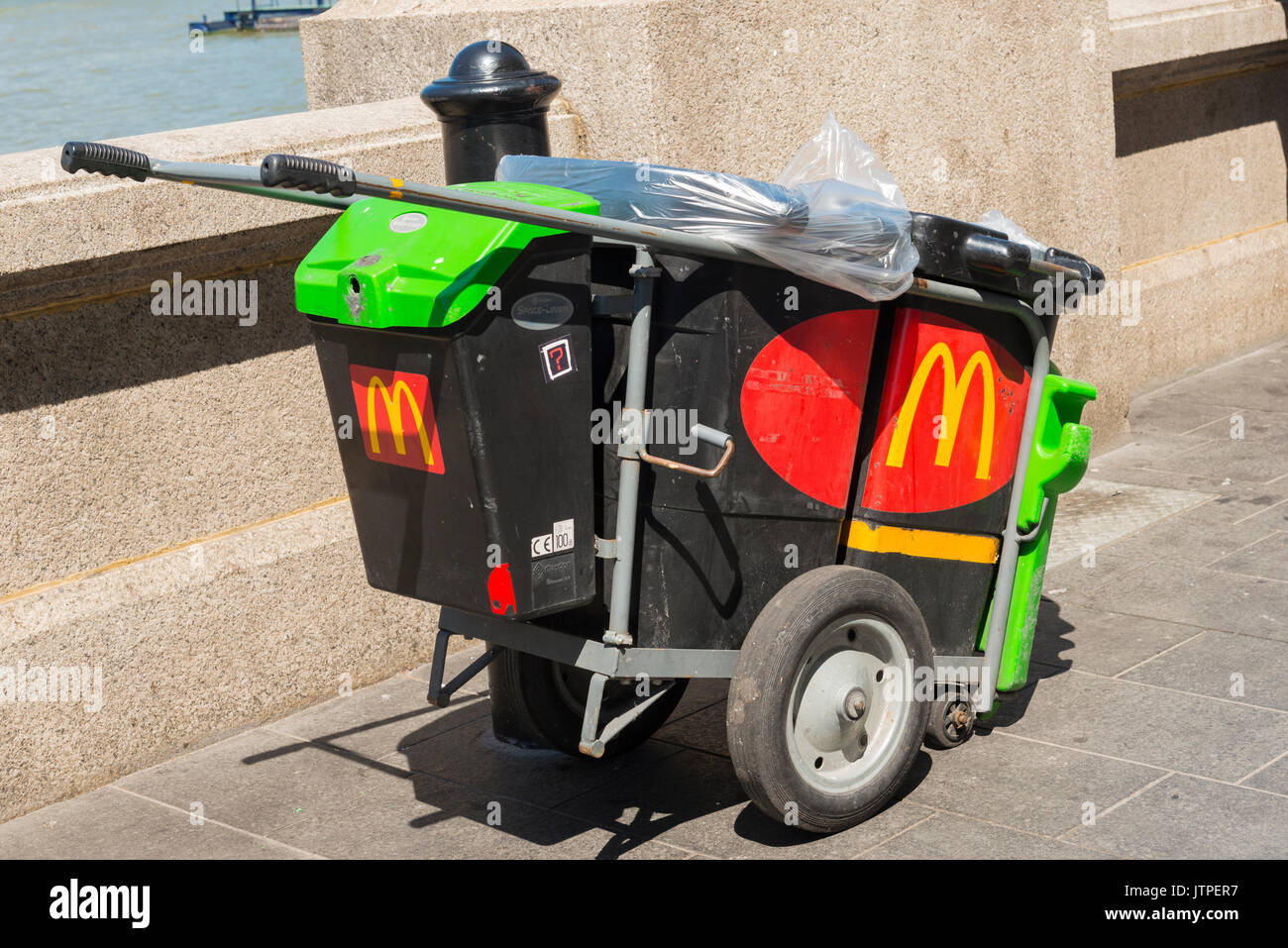 UK London Southbank McDonalds dust trash garbage rubbish litter cart trolley fast food cafe restaurant embankment water River Thames Keep Britain Tidy - Stock Image
