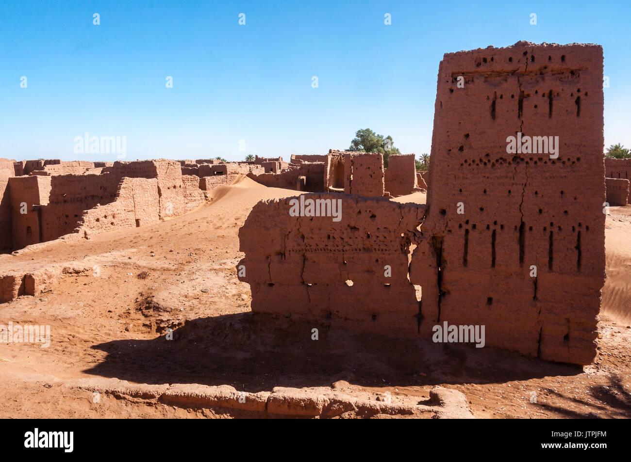 Abandoned Kasbah at sund dunes - Stock Image