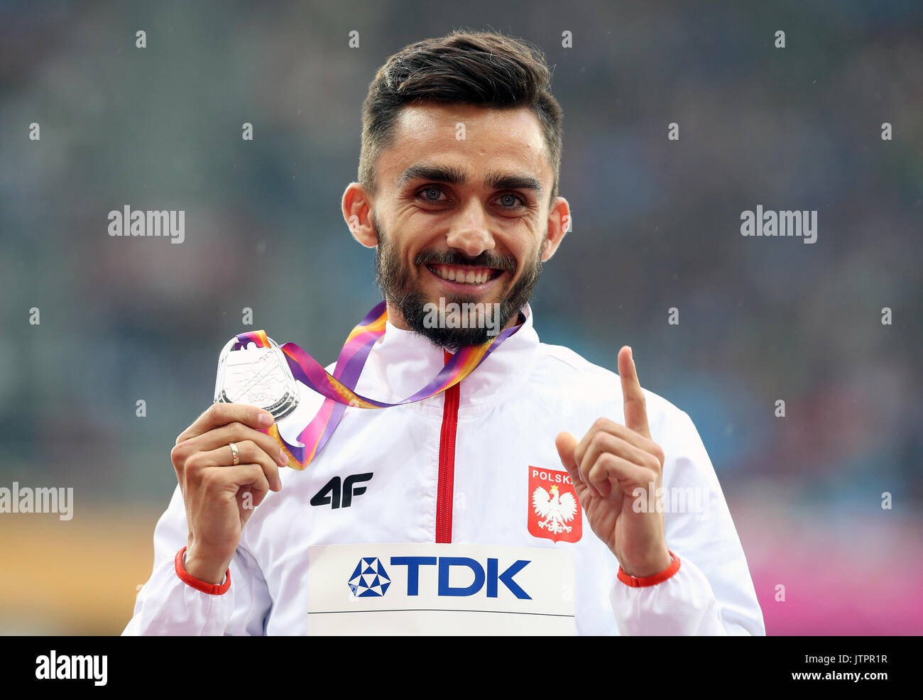 Poland's Adam Kszczot with his Silver medal from the Men's 800m during day six of the 2017 IAAF World Championships at the London Stadium. - Stock Image