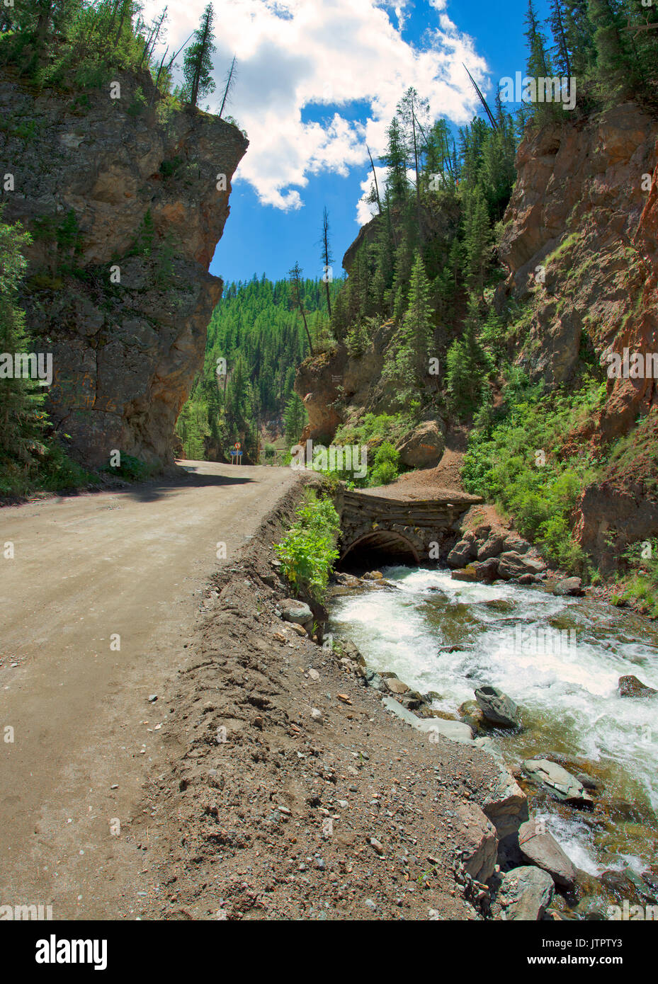 Red Gates pass. Altai mountains. River in the red rocks - Stock Image