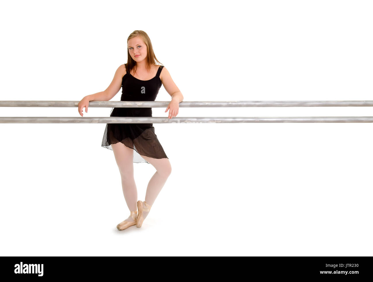 Teenage Ballerina Dancer at the Barre used for Ballet Class - Stock Image