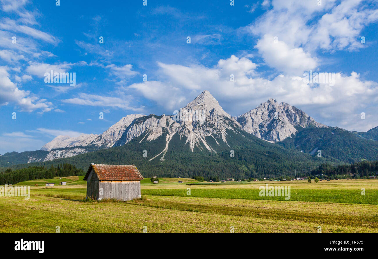 Austria, Northern Limestone Alps in the Eastern Alps, hay shacks in the Ehrwald Basin at Lermoos with view of the Mieminger Range - Stock Image