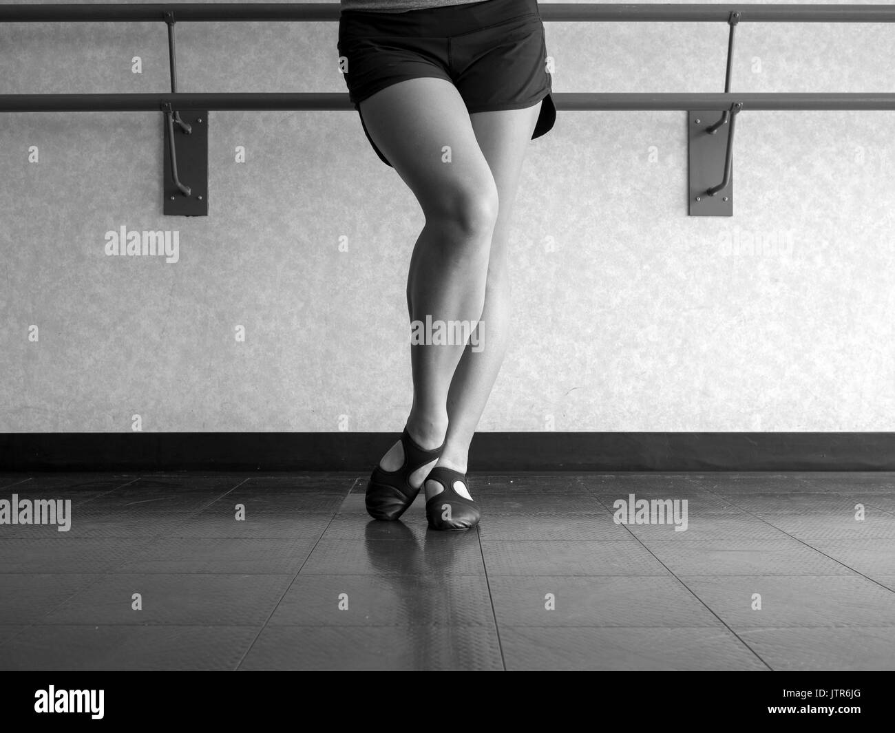 black and white version of Dancer with Bevelled foot in Jazz dig position - Stock Image