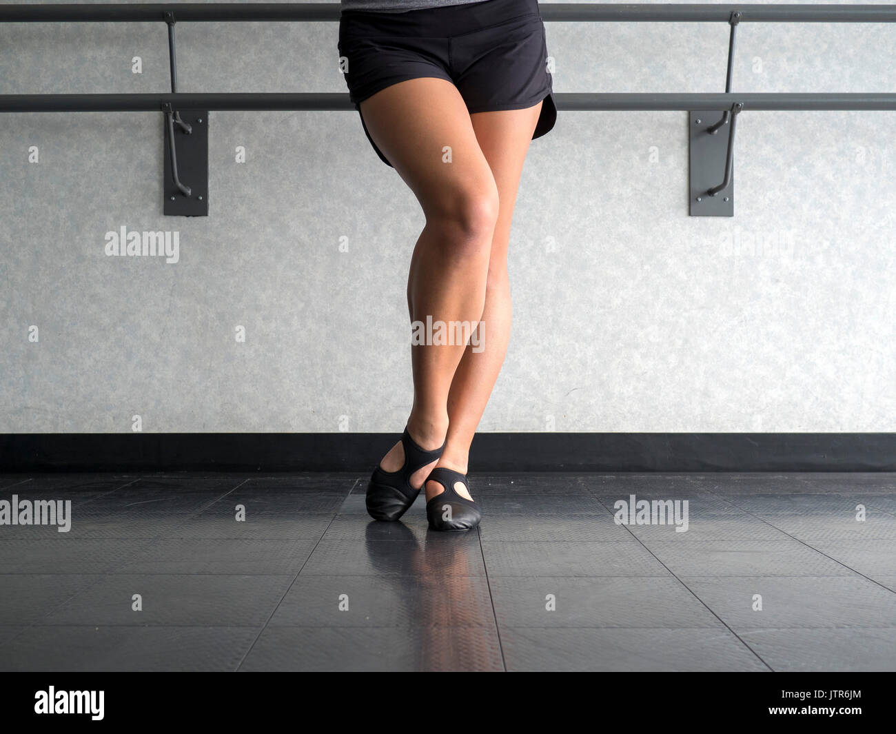 Dancer with Bevelled foot in Jazz dig position - Stock Image
