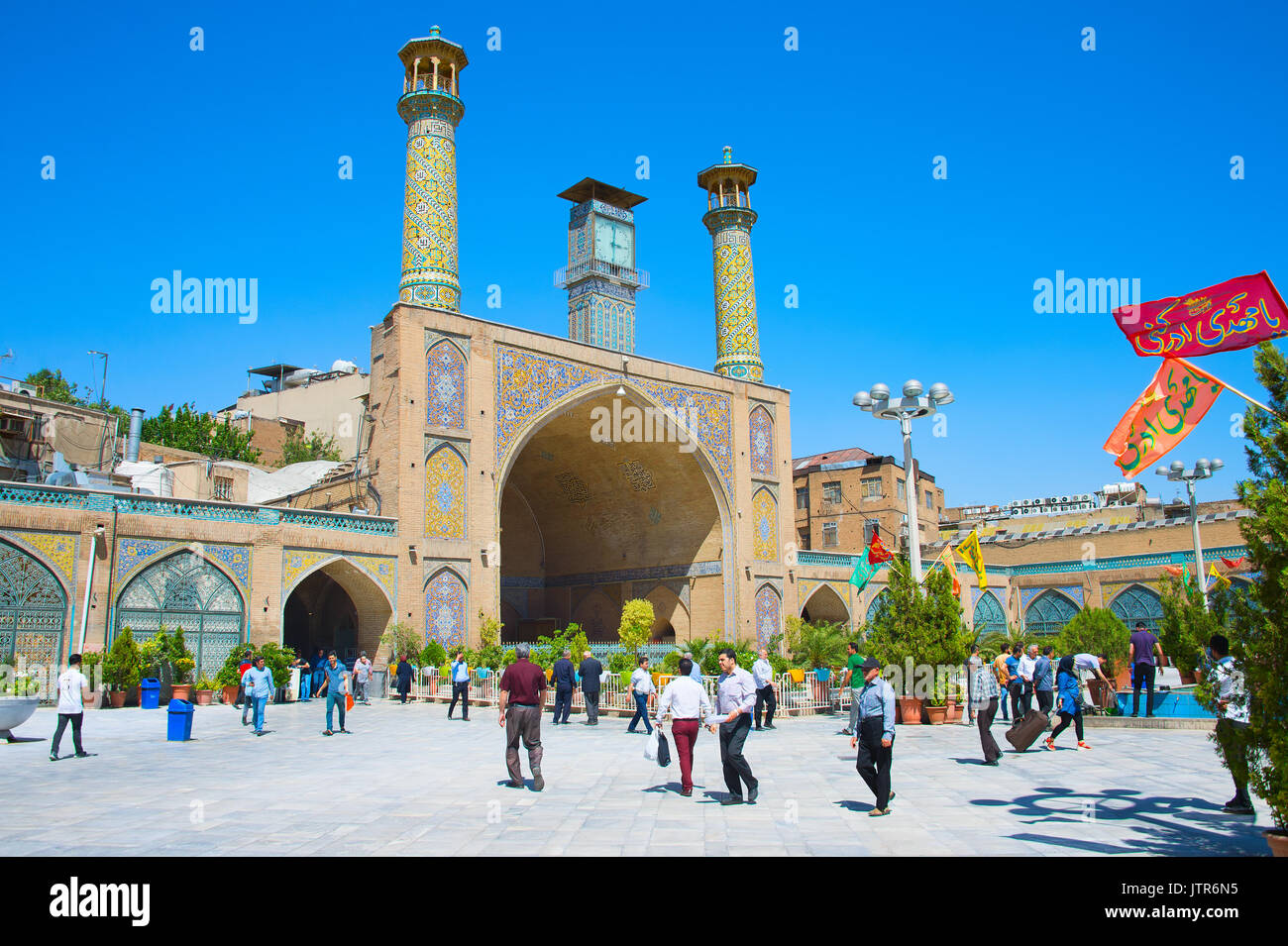 TEHRAN, IRAN - MAY 22, 2017: People walking at the Shah Mosque, also known as the Imam Khomeini Mosque is a mosque in the Grand Bazaar in Tehran, Iran - Stock Image