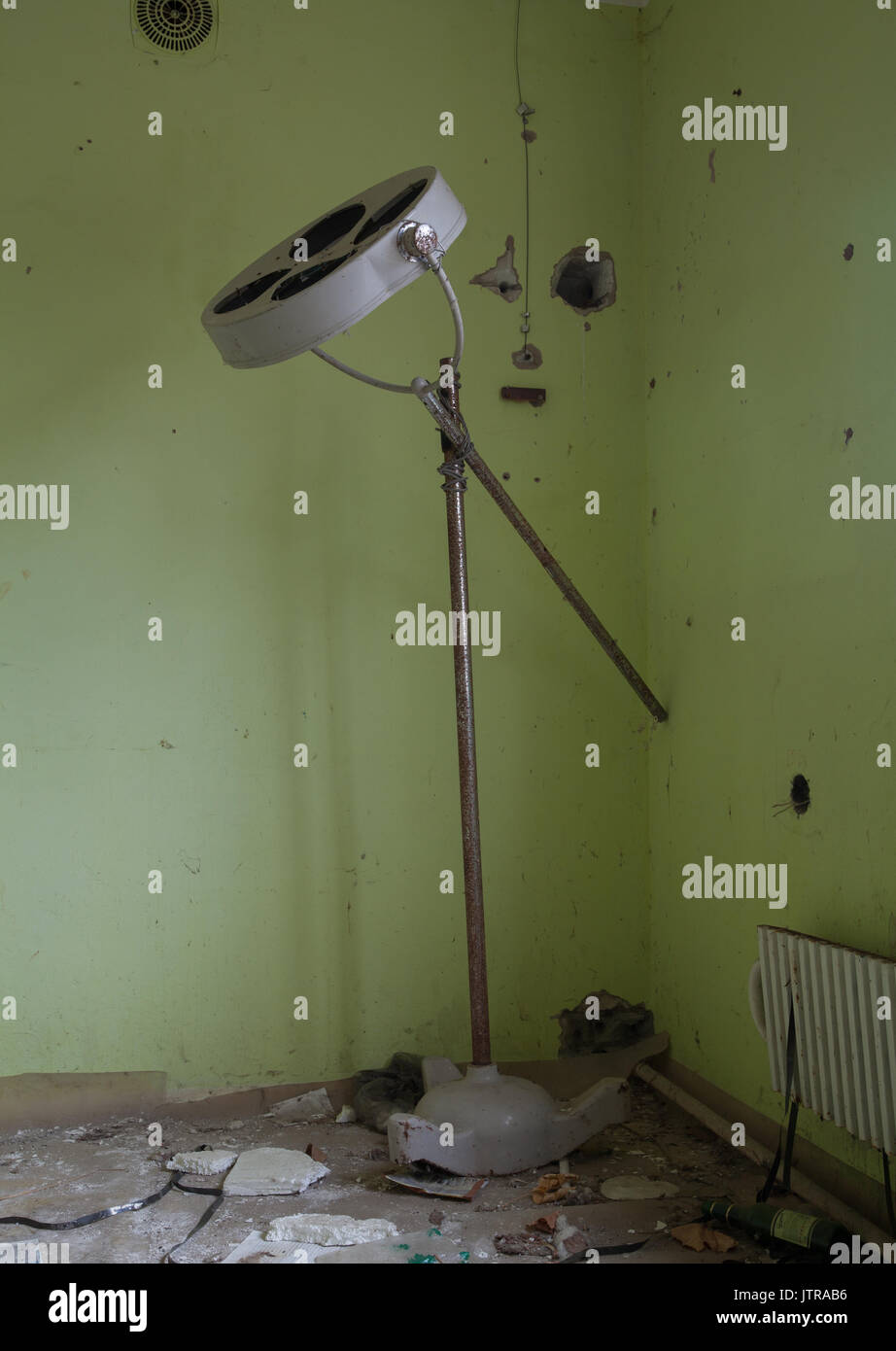 Operating lamp in an abandoned hospital within the 30km exclusion zone of Chernobyl. The area now vacant of people which was once a bustling town - Stock Image