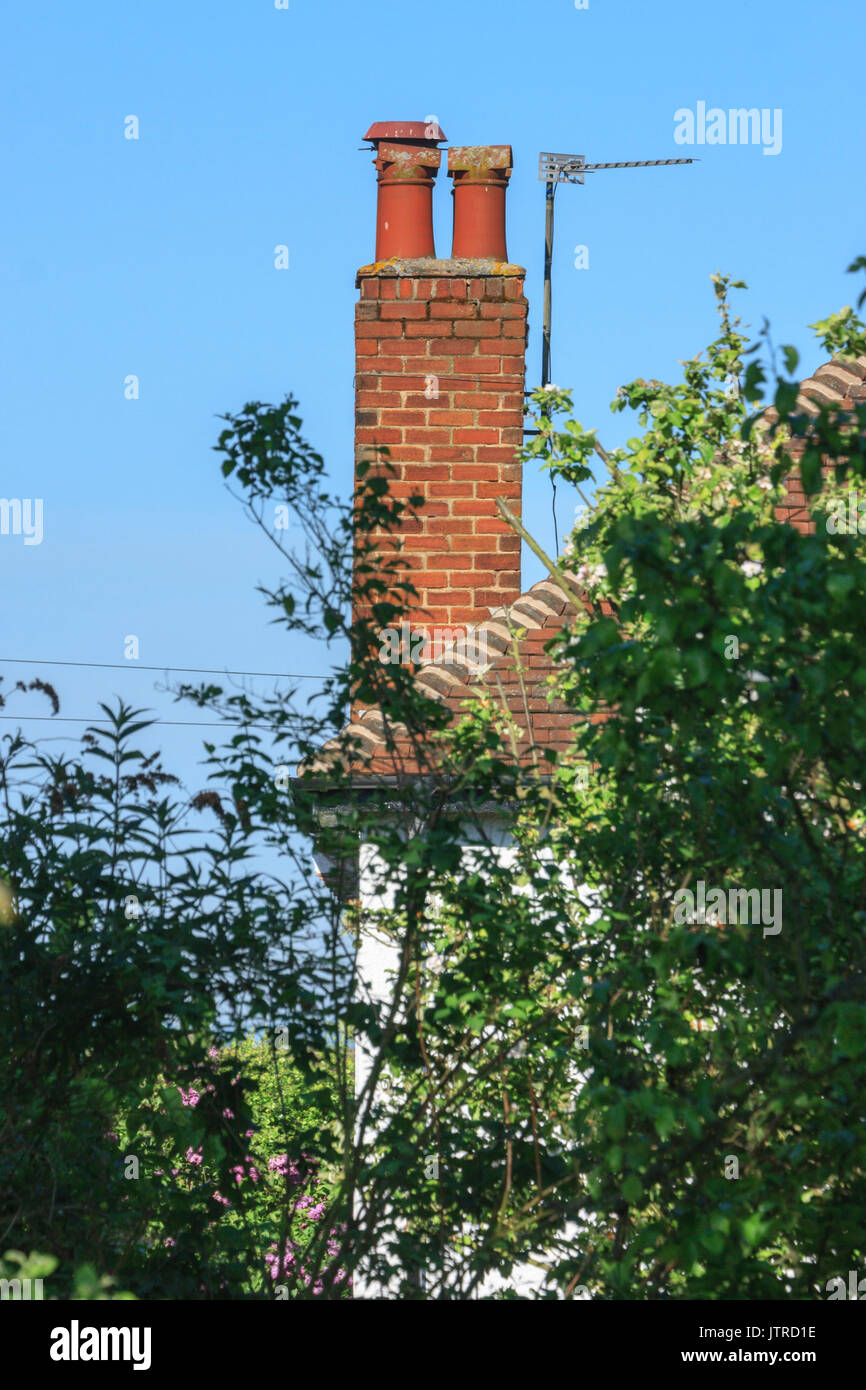 Chimney pots and TV aerial on a 1930 house England UK - Stock Image