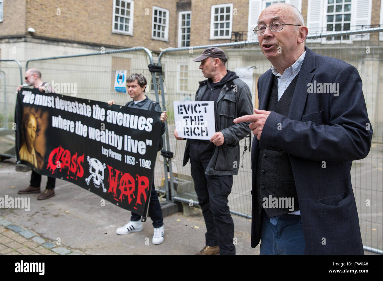 London, UK. 10th August, 2017. Ian Bone of Class War is interviewed during a protest outside Duke's Lodge in Holland Park, an empty apartment block believed to be owned by Christian Candy's Guernsey-based CPC Group, to draw attention to social housing required by former residents of the Grenfell block in North Kensington. Credit: Mark Kerrison/Alamy Live News - Stock Image
