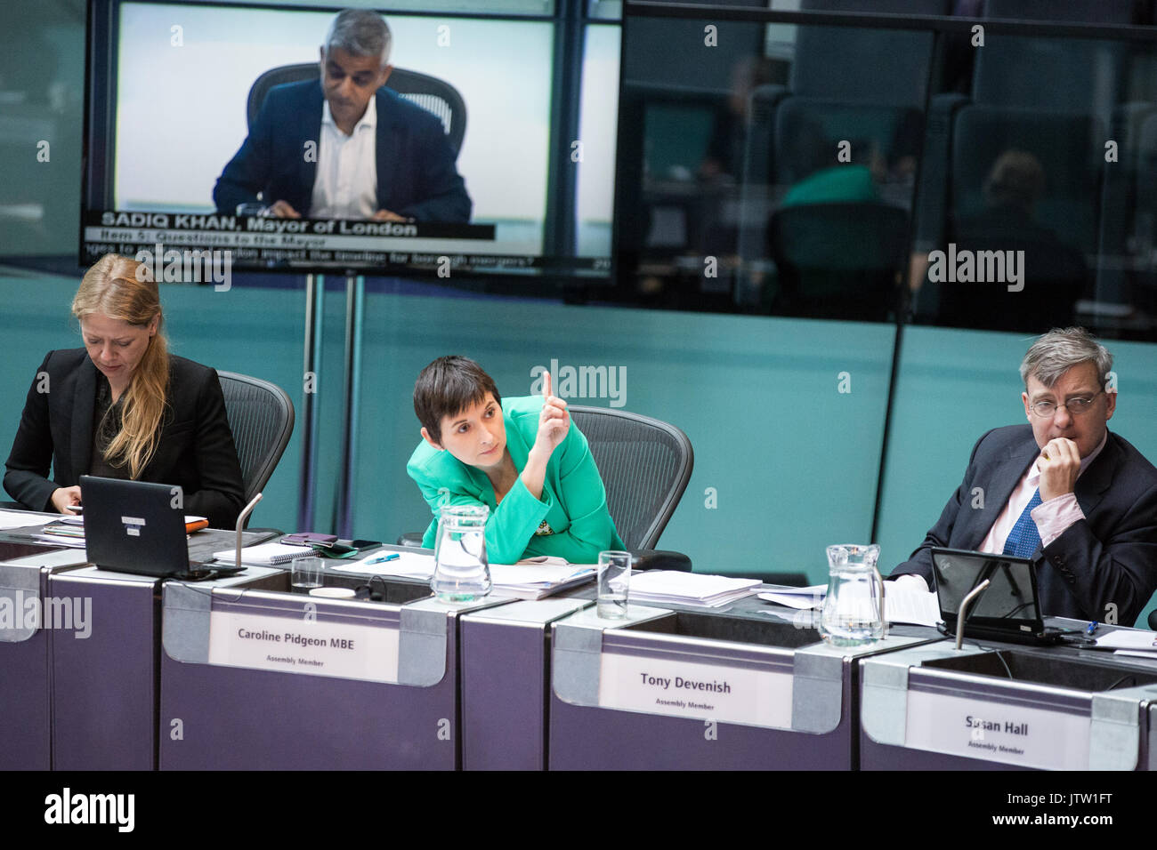 London, UK. 10th August, 2017. London Assembly Member Caroline Pidgeon MBE attracts the attention of the chair during Mayor's Question Time at City Hall. Among topics discussed were: acid attacks, social housing, expenditure on fire, 4G coverage on underground trains and police services and noise from overnight underground trains. Credit: Mark Kerrison/Alamy Live News - Stock Image