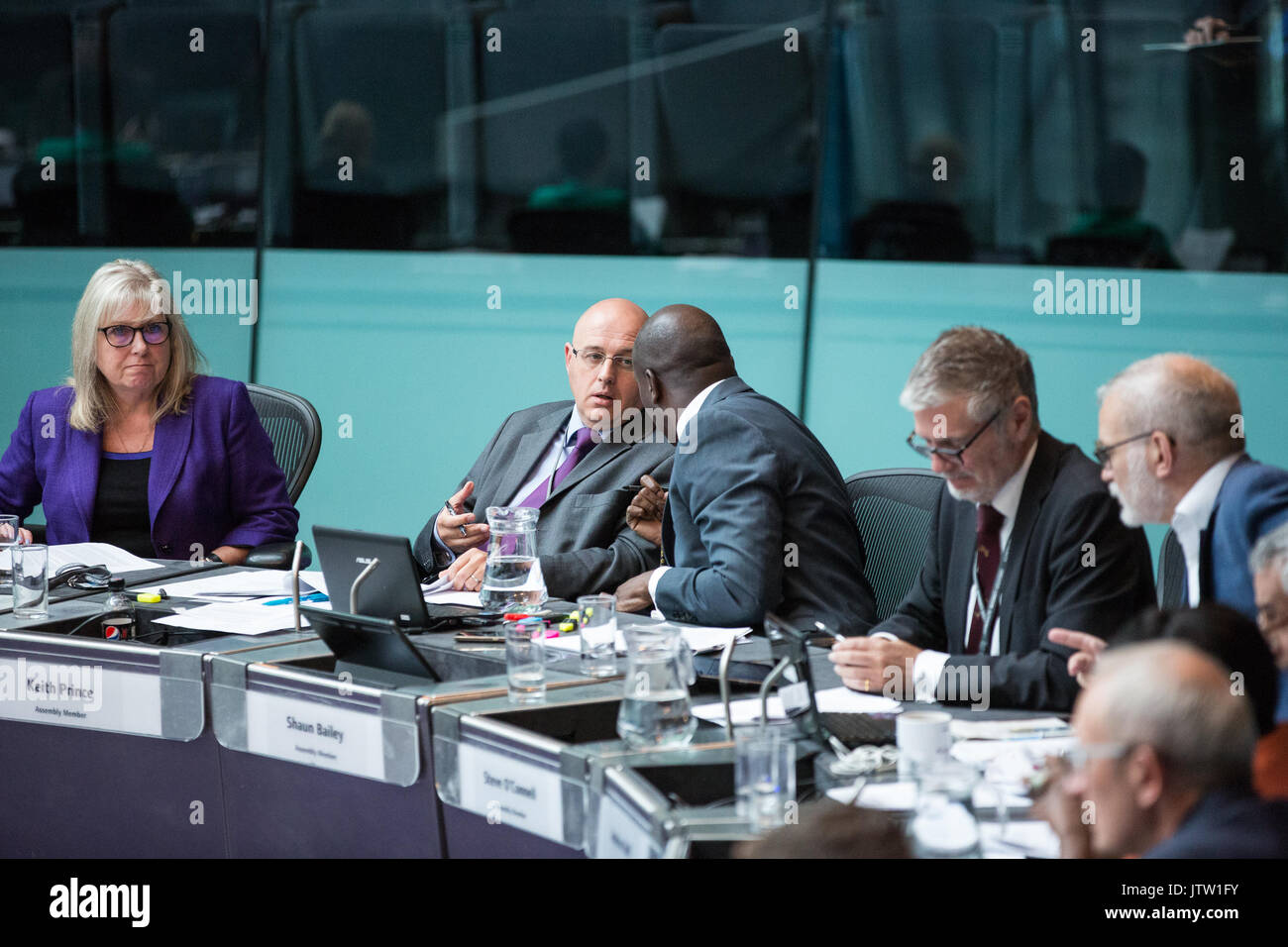 London, UK. 10th August, 2017. London Assembly Members Keith Prince and Shaun Bailey converse during Mayor's Question Time at City Hall. Among topics discussed were: acid attacks, social housing, expenditure on fire and police services, 4G coverage on underground trains and noise from overnight underground trains. Credit: Mark Kerrison/Alamy Live News - Stock Image