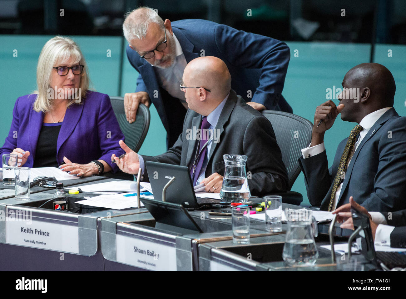 London, UK. 10th August, 2017. London Assembly Members Andrew Boff and Keith Prince converse during Mayor's Question Time at City Hall. Among topics discussed were: acid attacks, social housing, expenditure on fire and police services, 4G coverage on underground trains and noise from overnight underground trains. Credit: Mark Kerrison/Alamy Live News - Stock Image