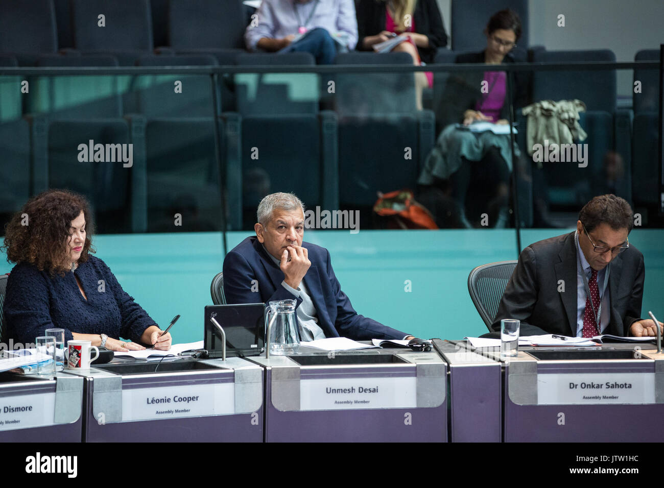 London, UK. 10th August, 2017. London Assembly Members Leonie Cooper, Unmesh Desai and Dr Onkar Sahota listen to Mayor of London Sadiq Khan responding to questions during Mayor's Question Time at City Hall. Among topics discussed were: acid attacks, social housing, expenditure on fire and police services, 4G coverage on underground trains and noise from overnight underground trains. Credit: Mark Kerrison/Alamy Live News - Stock Image