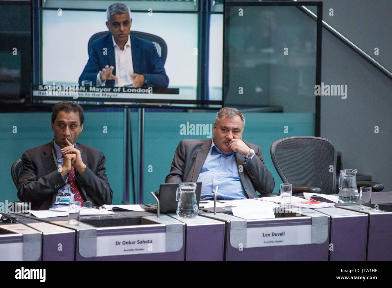London, UK. 10th August, 2017. London Assembly Members Dr Onkar Sahota and Len Duvall listen to Mayor of London Sadiq Khan responding to questions during Mayor's Question Time at City Hall. Among topics discussed were: acid attacks, social housing, expenditure on fire and police services, 4G coverage on underground trains and noise from overnight underground trains. Credit: Mark Kerrison/Alamy Live News - Stock Image