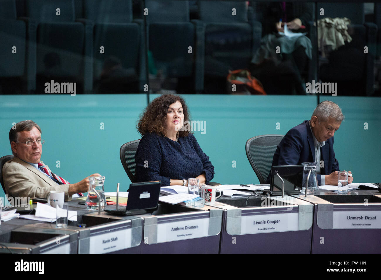 London, UK. 10th August, 2017. London Assembly Members Andrew Dismore, Leonie Cooper and Unmesh Desai listen to Mayor of London Sadiq Khan responding to questions during Mayor's Question Time at City Hall. Among topics discussed were: acid attacks, social housing, expenditure on fire and police services, 4G coverage on underground trains and noise from overnight underground trains. Credit: Mark Kerrison/Alamy Live News - Stock Image