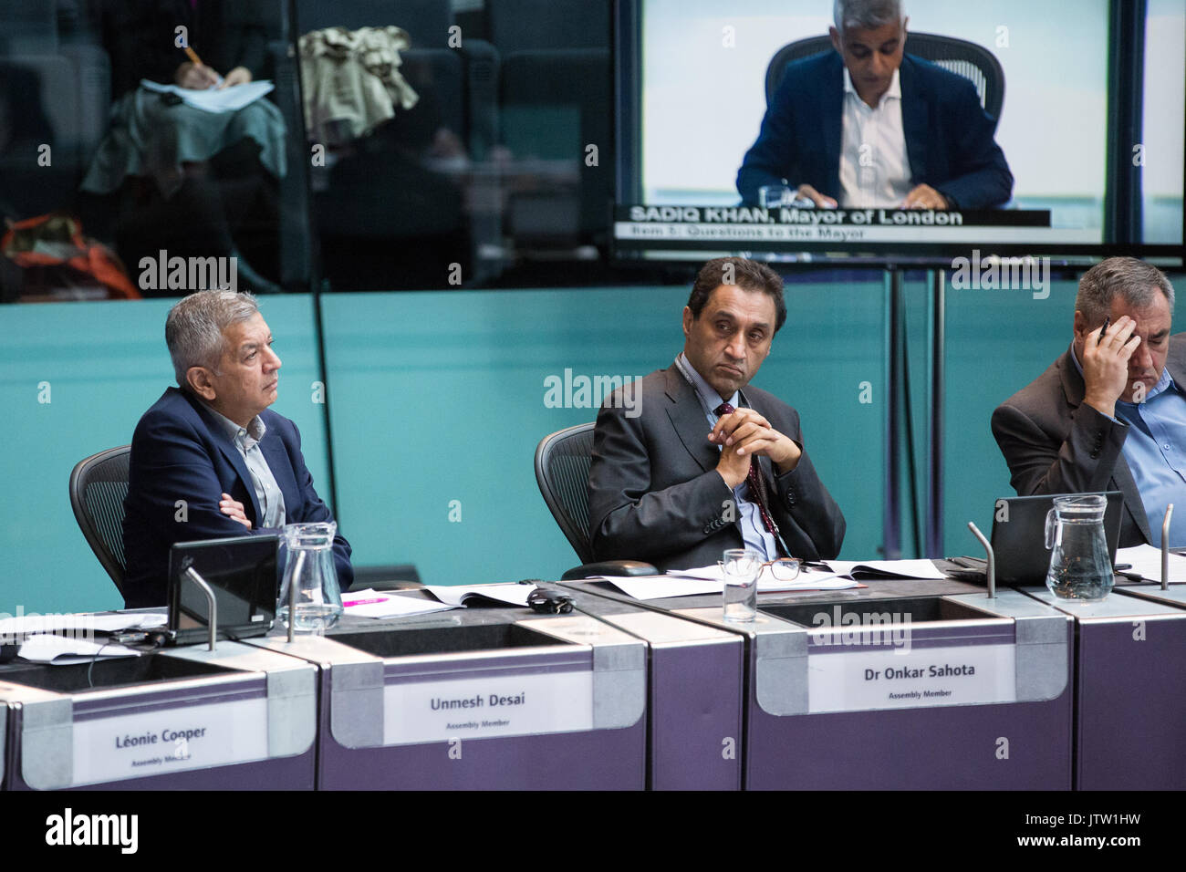 London, UK. 10th August, 2017. London Assembly Members Unmesh Desai, Dr Onkar Sahota and Len Duvall listen to Mayor of London Sadiq Khan responding to questions during Mayor's Question Time at City Hall. Among topics discussed were: acid attacks, social housing, expenditure on fire and police services, 4G coverage on underground trains and noise from overnight underground trains. Credit: Mark Kerrison/Alamy Live News - Stock Image