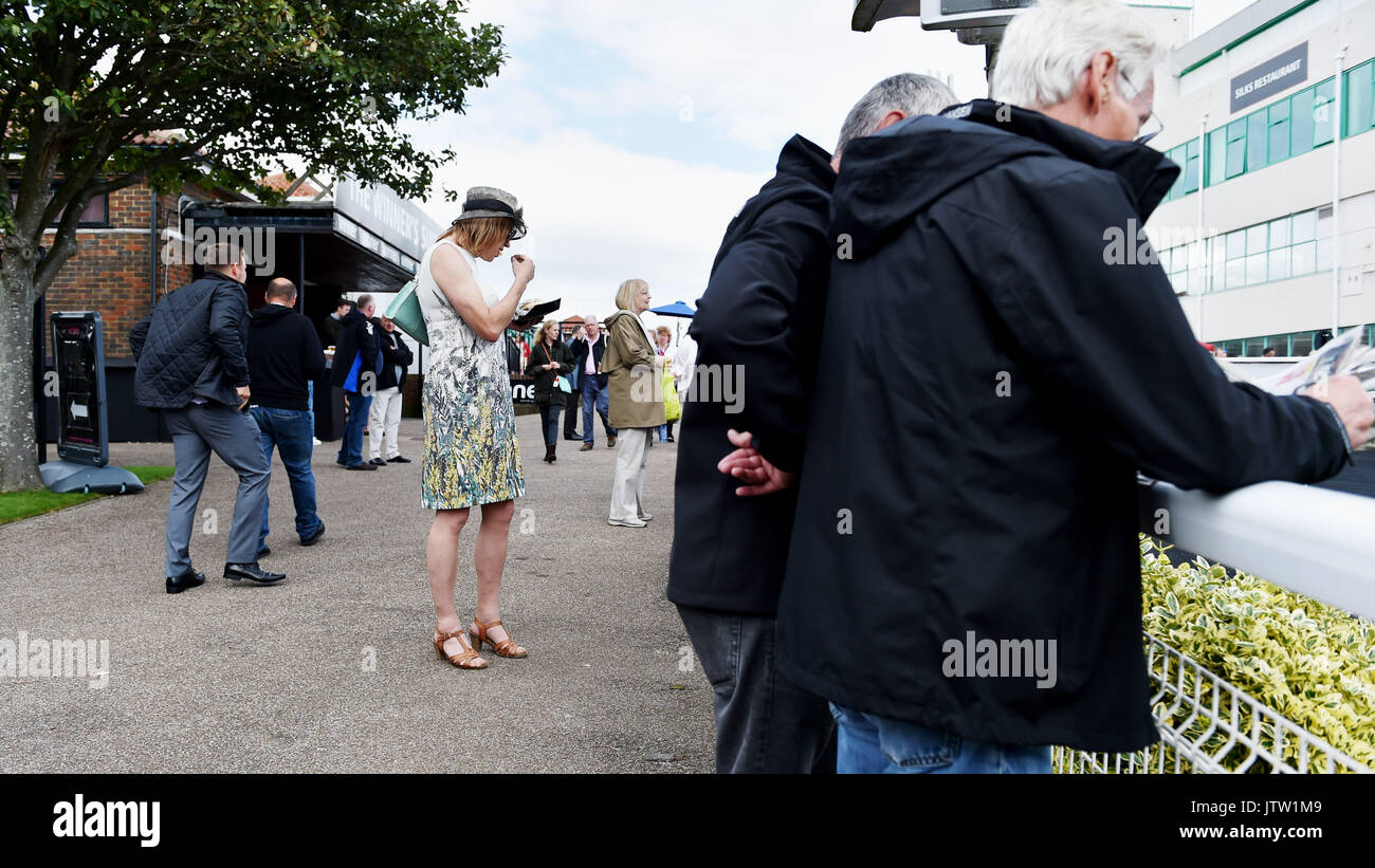 Brighton, UK. 10th Aug, 2017. Racegoers enjoying themselves at Brighton Races Route Mobile Ladies Day during the three day Maronthonbet Festival of Racing Credit: Simon Dack/Alamy Live News - Stock Image
