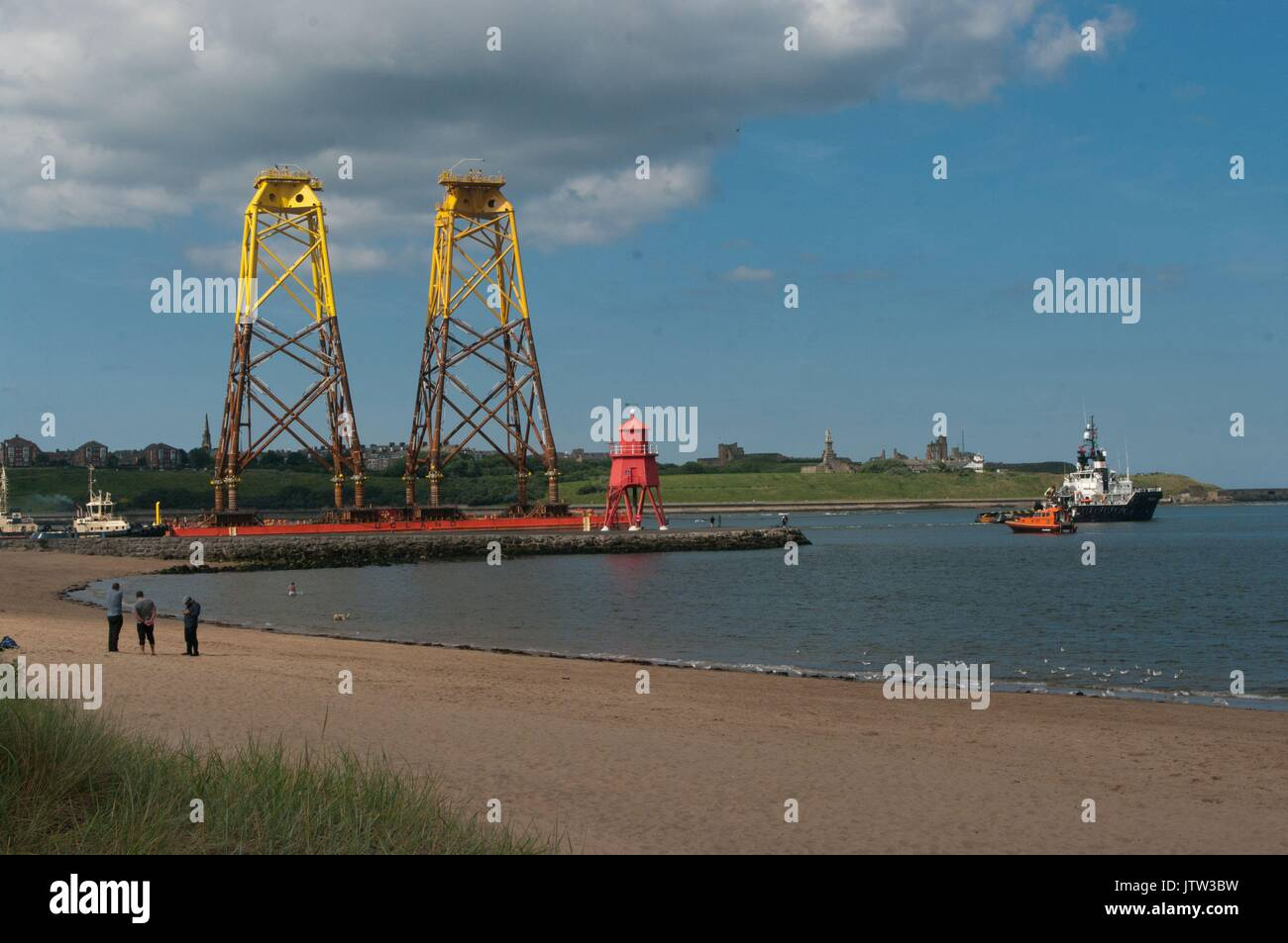 River Tyne, South Shields, UK, 10th August 2017. Wind turbine foundations being towed past The Groyne, South Shields Stock Photo