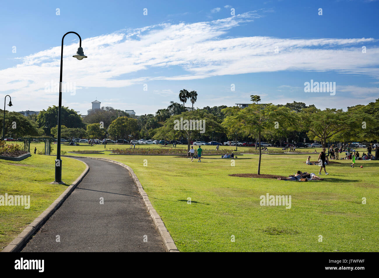 People enjoying the warm weather of a winter Sunday in New Farm Park, Brisbane, Australia - Stock Image
