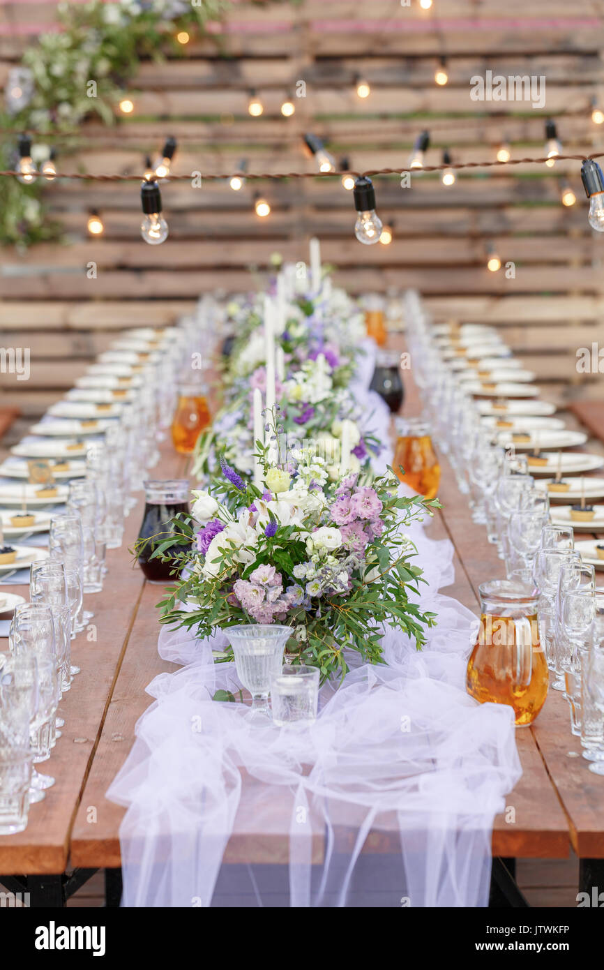 Glasses on the festive table setting. Wedding table decor concept. Table setting in classic style, setout. fine art. - Stock Image
