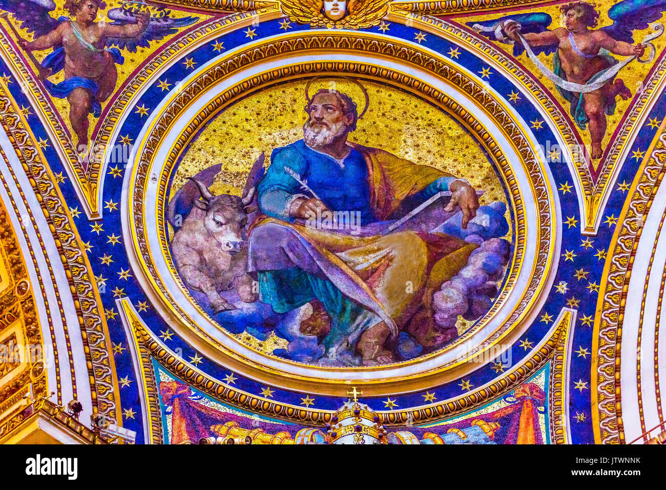 Saint Luke Winged Ox Gospel Writer Evangelist Mosaic Angels Saint Peter's Basilica Vatican Rome Italy.  Mosaic right below Michaelangelo's Dome, Creat - Stock Image