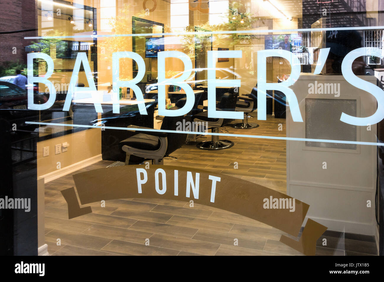 Barber's Point, a new SoHo shop in Lower Manhattan, opened in the summer of 2017 to cut men's hair and trim beards Stock Photo