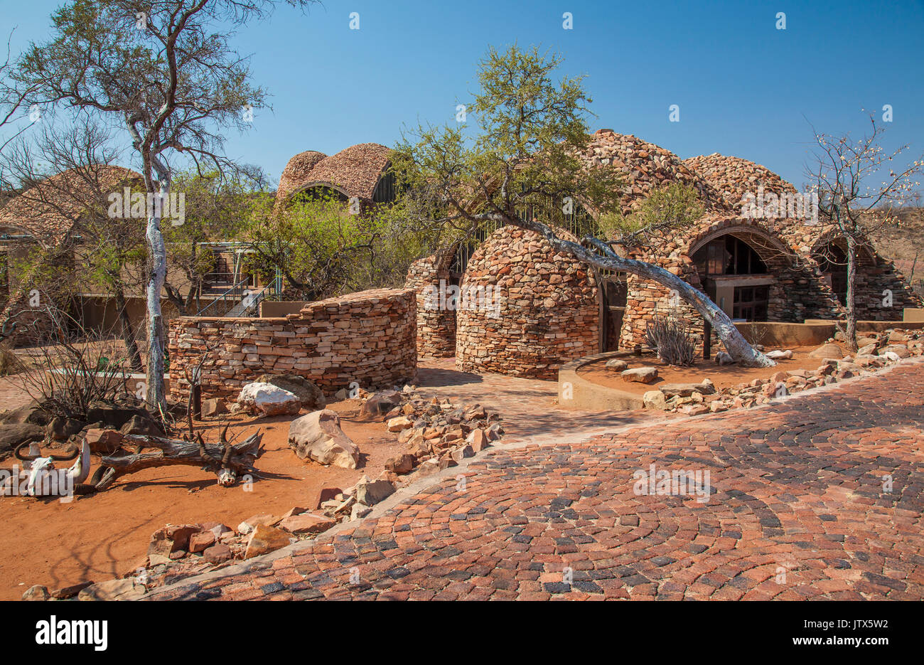 The innovative  Mapungubwe Museum and Interpretive Centre with its rock covered domes in the Mapungubwe National Park houses priceless artifacts of an - Stock Image