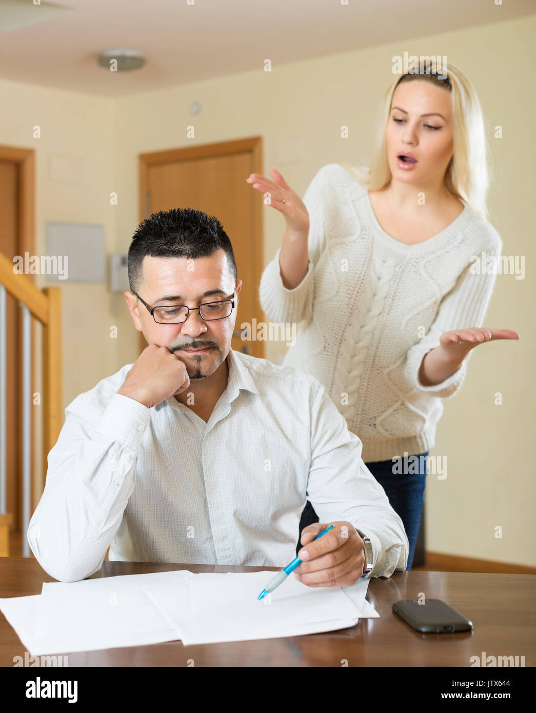 Quarrel in the couple due to lack of money Stock Photo